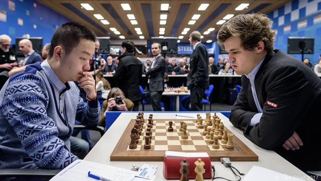 Вэй И (Китай) и Магнус Карлсен (Норвегия)