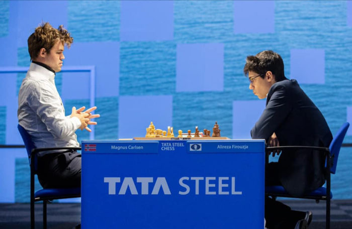 Магнус Карлсен (Норвегия) и Алиреза Фируджа (Иран). Шахматный турнир в Вейк-ан-Зее 2021, тур 1